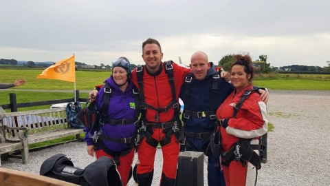 Jason and Friends Flying High After Skydive Success!
